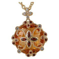 Citrine Pendant with 6/10 Carat of Garnets & 0.13 Cttw. of Diamonds https://www.goldinart.com/shop/necklaces/colored-gemstones-necklaces/17-carat-citrine-pendant-610-carat-garnets-13-carats-diamonds #18KaratYellowGold, #CitrinePendant