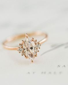 Give a little spark to your look by wearing this exquisite ring! Love how the marquise-cut is flanked with three small diamonds on each sides, all wrapped in a rose gold. Elegant with a hint of vintage! Who wants something like this too? Hands up! Photgoraphy by /lynndunston/ via /weddingchicks/