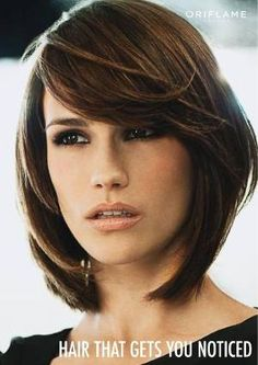 Layered bob with long side swept bangs- when I decide to cut my hair completely off again... I like this