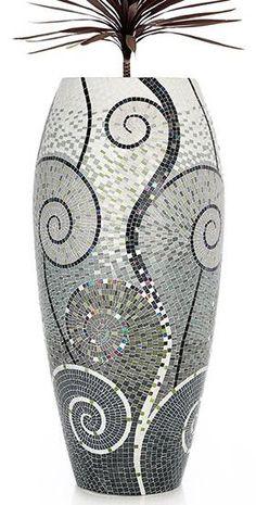 Beautiful mosaic vase. I like the art deco design.