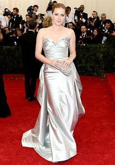 Amy Adams is radiant in a silver silk duchess satin gown by Oscar de la Renta at the 2014 Met Gala