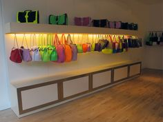 Purses are just as important as tops, right? We love this creative display technique (not seen very often) in which purses take the spot of clothes. Diy Purse Display, Bag Store Display, Diy Purse Organizer, Handbag Display, Store Displays, Handbag Storage, Display Ideas, Shop Interiors, Retail Design