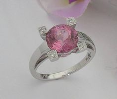 Another ring featuring a stone cut from the 'Queen of Dushanbe' 495ct Tajikistan Pink Spinel rough. This ring features a 3.07 Pink Spinel, cut by John Bailey in a modified Portuguese Round design. Accented by 0.06ct of fine white diamonds, nestled at the top of the prongs holding the main stone. The spinel has a few very light inclusions not visible to the naked eye. The stone is full of life and is the most luscious vivid pink associated with the finest pink spinel.
