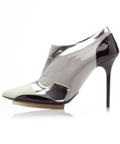 "BALENCIAGA Silver Ankle Booties with Mint Tip. These #Balenciaga pointed•toe ankle #booties are a #celebrity #favorite. Shoes are #leather crafted with rubber soles and contrasting #mint tips. This #futuristic design is detailed with #silver and #black panels, a 4"" heel, ankle cut opening and zip closure at side. 