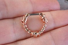 16 gauge rose gold barbed wire septum clicker or daith clicker. Overall inner dimension of this nose piercing is 10mm. The rose gold barbwire clicker bar is made of 316L surgical steel, and the body i
