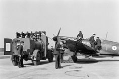 """Spitfire Mk I YT-T is captured by LIFE photographer William Vandivert being refuelled in a blast pen at RAF Northolt in March 1940. Assigned to F/O Roland RS """"Bob"""" Tuck, the aircraft was coded FZ-L until the outbreak of war in September 1939. By May, the original full-colour pre-war roundels had been reduced in size on the fuselage and wings."""