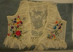 This is a repurpesed top made from a  front piece of an old silk coated.  I used a tattet lace doily that I took apart and reshaped so it will fill up the back where I ran out of material.