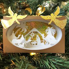 Do you have a favorite animal/character in the nativity scene? Paper Ornaments, Christmas Ornaments To Make, Christmas Paper, Handmade Ornaments, 3d Paper Art, 3d Paper Crafts, Custom Decals, Vinyl Decals, Cricut Design