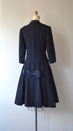 Vintage 1940s navy blue midweight wool coat with double breasted button, wide navy ribbon detail and bow around the skirt, 3/4 sleeves and silk lining. --- M E A S U R E M E N T S ---  fits like: small shoulder: 15 bust/chest: up to 34 waist: up to 29 hip: free length: 44 brand/maker: Miss Burns | Oak Park condition: excellent  ★ layaway is available for this item  ➸ More vintage coats http://www.etsy.com/shop/DearGolden?section_id=5800175  ➸ Visit the ...