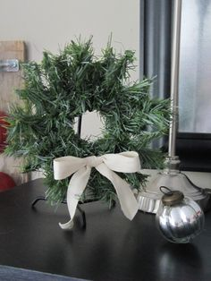 Sew Many Ways...: Tool Time Tuesday...Mini Christmas Wreath Recycling worn out evergreen garland & rubber rings from candle jar lids
