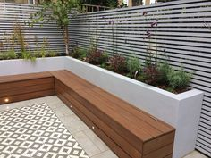 Custom hardwood seat with storage. Timber trellis screens. Perennial feature planting, Silver birch courtyard tree. Construction by Germinate Gardens.