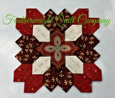 I LOVE, LOVE the fabrics is this Lucy Boston block kit! This Patchwork of the Crosses block features fabric is rich browns, warm rusts and