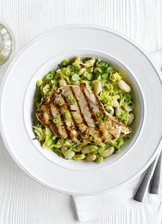 Chargrilled chicken with white beans and cabbage - quick idea for chicken breasts: ready quickly in 25 minutes this recipe for two includes an easy white bean and cabbage mix that makes a fast midweek meal.