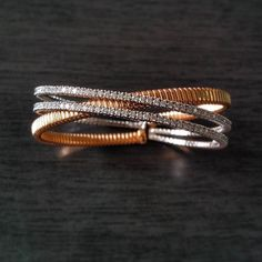 This rose & white gold intertwined bangle with white diamonds to adorn her wrists #AaryaJewelry  #DiamondJewelry #GoldJewelry #Bespoke #18k #Gold #Diamond #DiamondBangle  #GoldBangle #Luxury #LuxuryJewelry #Jewellery #Bangle #RoseGold #WhiteGold #Sparkles #ForHer #Gift #ForYou #Forever #DiamondsAreForever #GirlsBestFriend #WristGame #Beauty #Fashion #GIA #etsy #love #womensjewelry