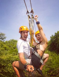 A perfect couple flying in a zip-line in Xplor Park, Cancun and Riviera Maya.