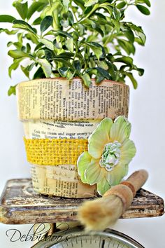 Mod podge terra cotta pots with fabric and a vintage recipe book 002