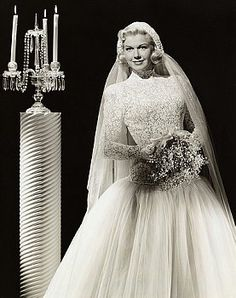 Actress Doris Day posing in a wedding dress (1950s?)