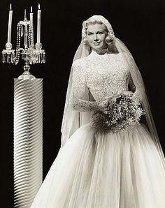 Actress Doris Day posing in a wedding dress (1950s?)