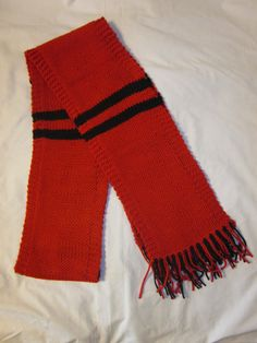 Red and Black Scarf. Hand knit scarf to show your team spirit. Measures about 65 inches long. 100% Acrylic Machine washable and dry low