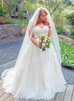 Natural waisted organza ball gown: lightweight and romantic-so flattering!! Found at Della Curva, Plus size Bridal salon Tarzana, CA .Photography by Jessica Fairchild Santa Barbara, CA