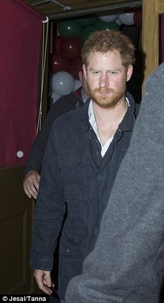 Harry looked bleary eyed as he emerged from the balloon-filled club...