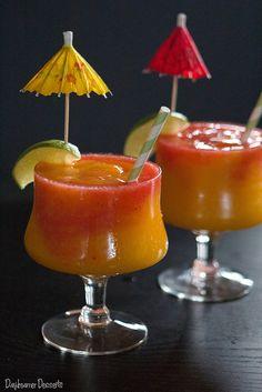 Mango Strawberry Swirl Daiquiri ~ (Mango Daiquiri: 1 large ripe mango 3 oz light rum 1 tsp sugar ½ oz lime juice Strawberry Daiquiri: 1 cup strawberries 2 oz light rum 2 tsp sugar ½ oz lime juice)