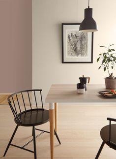 Almond Wisp (Behr paint color) on the wall of a dining room with Scandi decor. #behralmondwisp #almondwisp #paintcolors