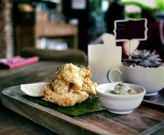 #Bali > while sit down on this lovely rustic cafe @watercressbali we enjoy a light and crispy batter Calamary as a comfroting and tasty starter