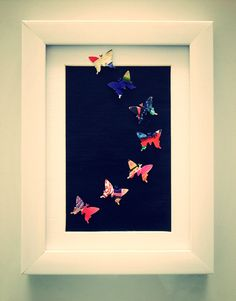 Recycled magazine art:  Vibrant butterflies by ThePaperGirl14