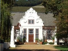 Cape Dutch Houses - characteristics of the architecture style that developed in Cape Town in the century - top architectural tourist attractions. See Cape Dutch gables and house plans of various heritage buildings of South Africa. Classic Architecture, Architecture Details, Single Storey House Plans, Architectural Features, Architectural Styles, Cape Dutch, Dutch House, Residential Architect, Courtyard House