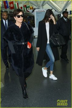 Kendall Jenner keeps her face hidden as she arrives to JFK Airport with her mom Kris Jenner on Monday (March 30) in New York City.