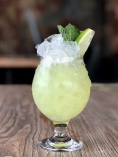 Absinthe Frappe - Absinthe, simple syrup, soda water, mint leaves