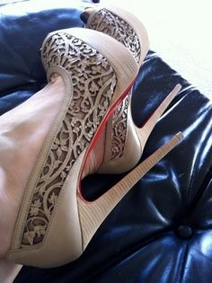 Must be a Louboutin shoe due to the red sole.  If so, out of my price range but will search for them anyways.