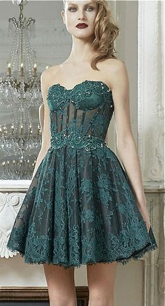 Green lace cocktail dress with bodice
