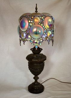 I will start at this lamp and sing Don Ho's Tiny Bubbles while sipping on champagne.