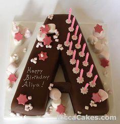 Marshmallow Letter Kid's Cake :]  http://www.kiccacakes.com/Cakes/Kids_Cakes/009_Colours_Wheel_Cakes.html