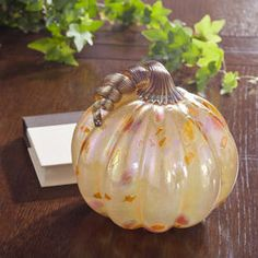 Pale Orange Speckled Pumpkin of Iridescent Blown Glass Glass Pumpkins, Pale Orange, Halloween Jewelry, Polish Pottery, Hand Blown Glass, Murano Glass, Glass Jewelry, Iridescent, Halloween Decorations