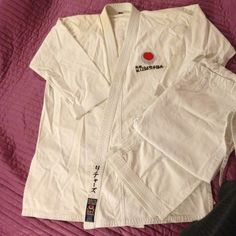 Authentic tokaido karate uniform I have a heavy weight authentic tokaido uniform, like new.   Photo 4 shows small stain (hardly noticeable) sorry black belt does not come with it.   Size 7, which would fit an adult medium to large. Tokaido Jackets & Coats