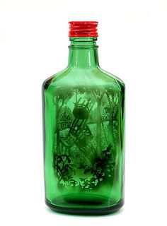 Jim Dingilian fills bottles with smoke and then carefully cleans away most of the soot, leaving just enough to form an image inside the bottle.