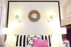 Black & White & Pink Bedroom - gold Sunburst mirror, pillow stripes, windsor smith and designer's guild fabrics