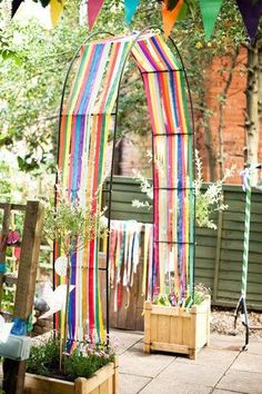 Streamers on an arch- lovely addition to a children's play area!