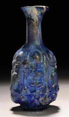 A ROMAN MOULD-BLOWN COBALT BLUE GLASS FLASK  CIRCA 1ST CENTURY A.D.