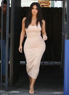 Hourglass: Kim Kardashian, 35, showed off her 26-inch waistline on Friday in a skintight dress