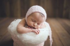 Light pink knitted baby hat. I absolutely love it.
