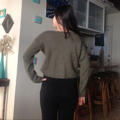 Dark Olive Green BM crop wool sweater BRANDY MELLVILLE Olive Green sweater bought last year. Rare. Wider size S and cropped length. Used condition. Wool. I am 5'2 so you can see its ends a little above my waist. Perfect to wear with a scarf or on a summer night! Please make an offer below. BUNDLE & get a discount Brandy Melville Sweaters Crew & Scoop Necks