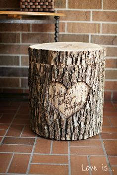 old tree stump made into storage stool, with a cute carving...TOO CUTE!!