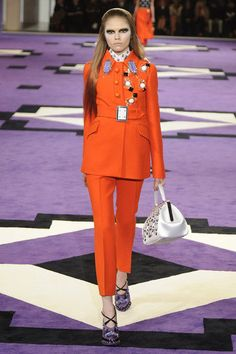 Prada Runway 2012 Fall: This line is full of embellished jewels, bright colors, and contrasting patterns all on structured suits.
