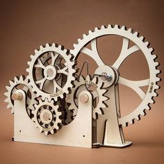 Intermittent drive mechanism for forthcoming automata. The drive input is at the rear. The output alternate between to two small gears with the pointed teeth. Paper Engineering, Mechanical Engineering, Gear Clock, Laser Cutter Projects, Lazer Cut, Gear S, Kinetic Art, Electronic Art, Automata