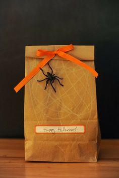 Halloween Treat Bag for teachers - have kids scribble a spiderweb on the front with a white crayon, attach spider ring, and close with a ribbon.
