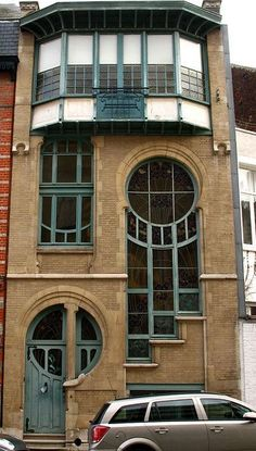 It was built by the architect Léon Delune in 1904. He left his 'signature' on the house in a very unique way - his last name means 'of the moon,' in French, and he worked images of the different phases of the moon into the design. The big window at the top was originally designed so that there would be enough natural light for a painter's studio at the top of the building.  It's located in Brussels, 6 Rue du Lac.